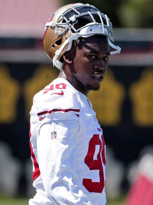 San Francisco 49ers linebacker Aldon Smith takes a break during NFL football training camp Friday, July 25, 2014, in Santa Clara, Calif. (AP Photo)
