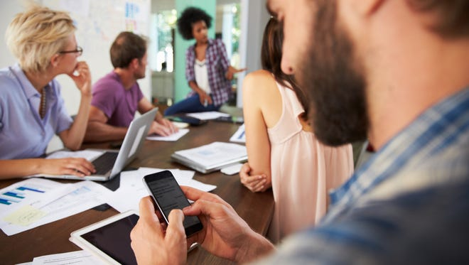 If you're texting at a meeting, you're sending the wrong message.