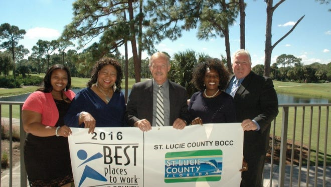 St. Lucie County Administrator Howard Tipton (center) accepts the 2016 Best Places to Work award with members of the Human Resources staff: Generalist Shanelle Benjamin (from left); Director Ceretha Leon; Manager Betty J. Jackson and Manager Douglas G. Baber.