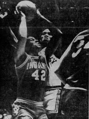 DETERMINED – That's what Indiana's Scott May (42) was as he went up for a shot against Kentucky's Jim Lee. May hit this one and wound up with 27 points in the Hoosiers' triumph.
