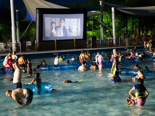 """Swimmers watch """"Alexander and the Terrible, Horrible, No Good, Very Bad Day"""" from the wave pool as part of the Dive 'n' Movies series at Wet 'n' Wild Phoenix waterpark in Glendale."""