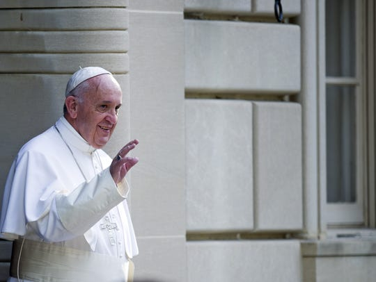 Pope Francis waves as he departs the Apostolic Nunciature,