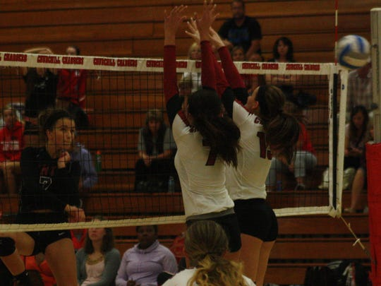 Canton's Gabrielle den Boer scorched this kill past a Churchill double block.