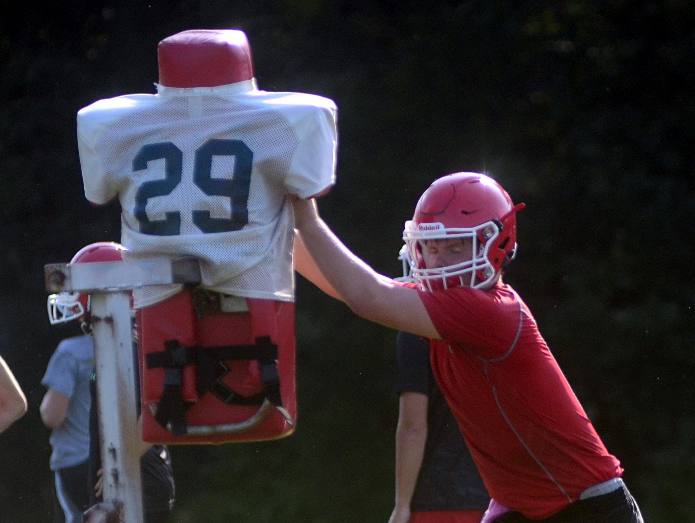 Westmoreland junior Blake Carter works with a blocking dummy during a preseason practice session.