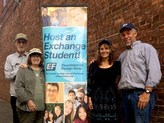 Lloyd Taber, from left, Patt Taber, Audrey Warkentin, Ron Warkentin, all local coordinators from Education First, a Boston, Mass., based student exchange program, pose for a photo in downtown Salem.
