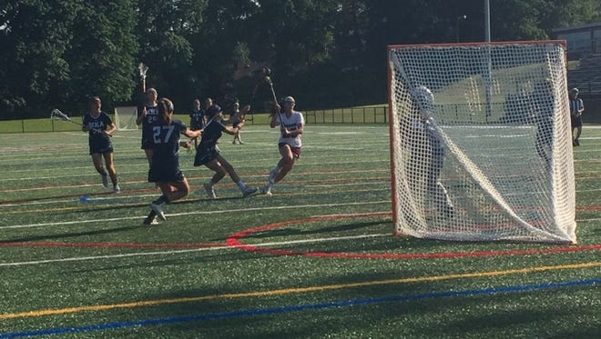 Verona senior Ava Anderson attacks the net against Montclair Kimberley.