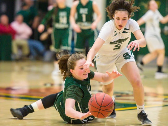Rice Memorial's Fiona Connolly, left, and St. Johnsbury's