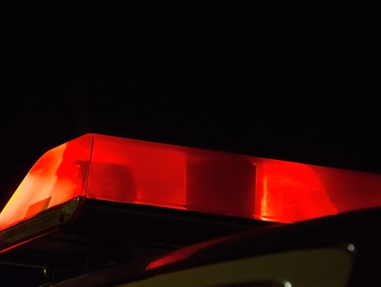 Red Police siren beacon light flashing on car
