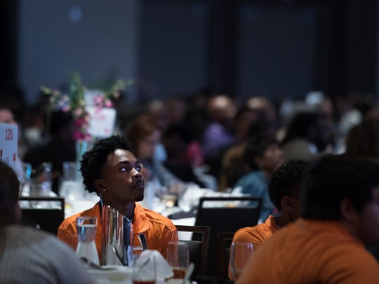 "A student watches as John Qui–ones, host of the ABC Show ""What Would You Do,"" speaks at Clemson University's Men of Color National Summit at the TD Convention Center on Friday, April 28, 2017."