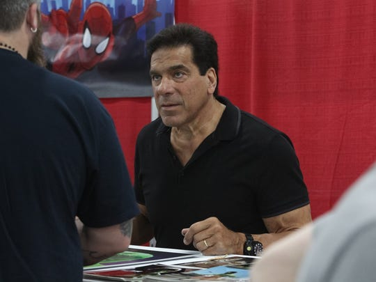 Actor Lou Ferrigno, left, best known for his lead role on the TV show 'The Incredible Hulk', greets guests at the 2017 Motor City Comic Con.