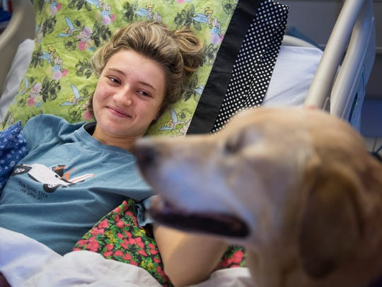Maryann Jarnagin, 16, gets a visit from Harley, a yellow