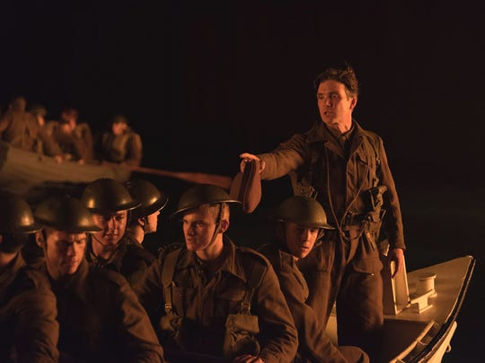 "Cillian Murphy (far right) oversees a group of Allied soldiers in the World War II action thriller ""Dunkirk."""