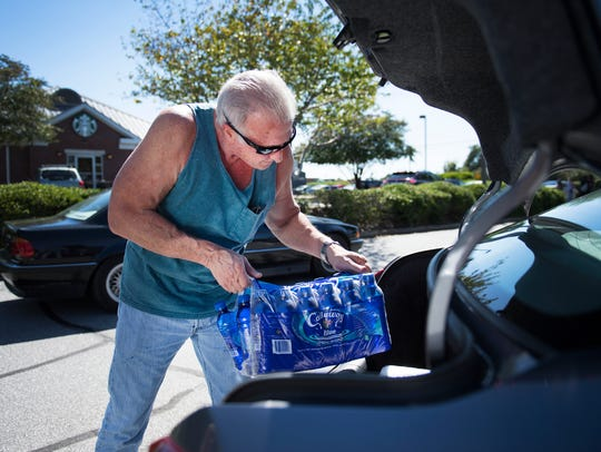 Frank Epstein of Simpsonville loads water into his