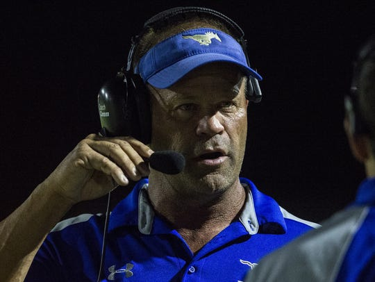 Dobson head coach Pete Wahlheim talks on the sideline