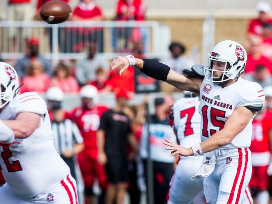 South Dakota quarterback Chris Streveler attempts a