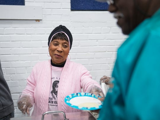 Brenda Springs dishes out grits during the Dr. Martin Luther King Jr. breakfast at the Sterling Community Center on Monday, January 15, 2018.