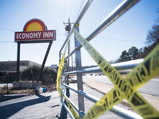 An entrance to the Economy Inn is blocked off on Thursday,