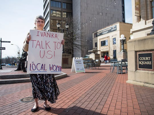 Lucinda Rogers of Travelers Rest, S.C., stands with a sign outside the Poinsett Hotel where Ivanka Trump was speaking on Friday, Jan. 26, 2018.