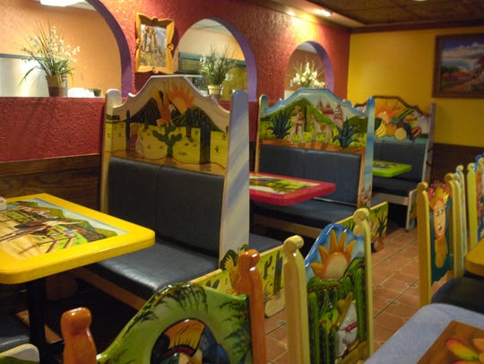 Colorful, intricate booths and chairs fill the dining