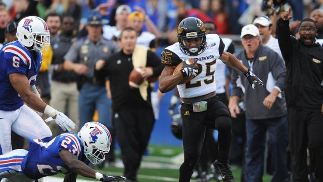 Southern Miss running back Ito Smith scores one of his three touchdowns against Louisiana Tech on Nov. 28.