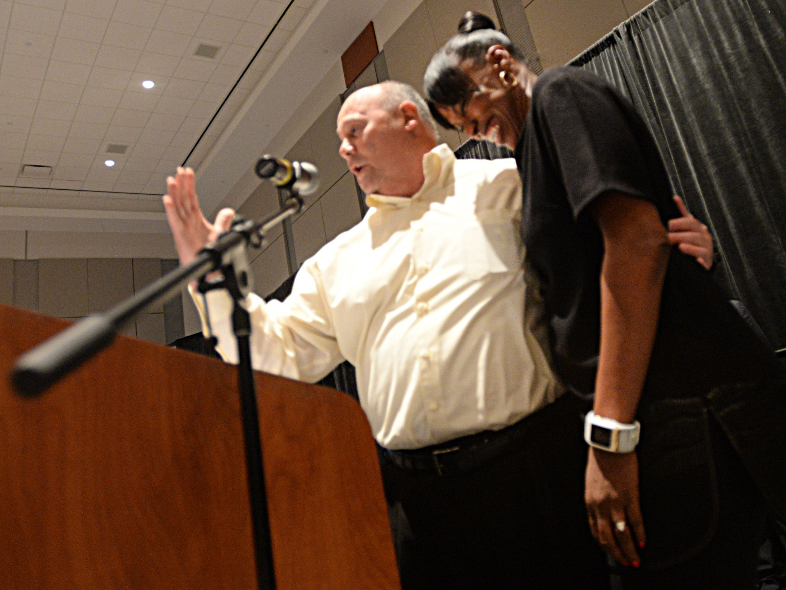 Calvary coach John Backman takes a moment to thank Jackie Joyner-Kersee for her speach.