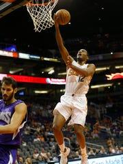 Phoenix Suns forward T.J. Warren makes a layup against