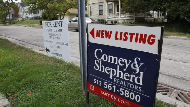 Homes are advertised for sale and rent along Observatory Avenue at Meier Avenue in Hyde Park.