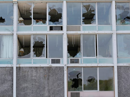 Broken windows throughout the former Holiday Inn and