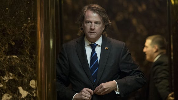 Don McGahn gets into an elevator in the lobby at Trump