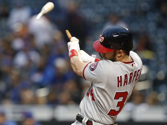 Washington Nationals' Bryce Harper hits a solo home run in the first inning of a baseball game against the New York Mets, Monday, April 16, 2018, in New York.