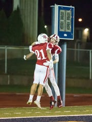 St. Philip's Brayden Darr and Drew Lantinga celebrate after a touch down Friday evening.