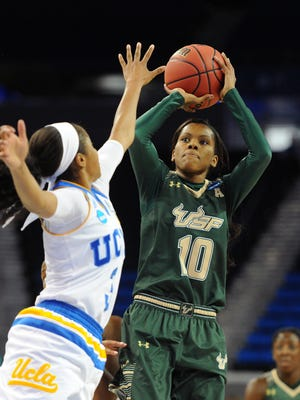 South Florida's Courtney Williams (10) shoots against UCLA's Jordin Canada during a second-round NCAA Tournament game in Los Angeles on Monday, March 21, 2016.