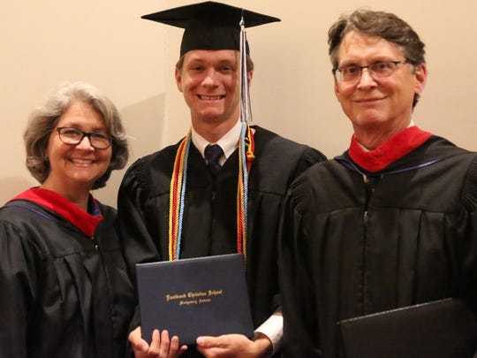 John Geiger with his youngest son, Nolin, who graduated last month from Eastwood, and John's wife, Dawn.