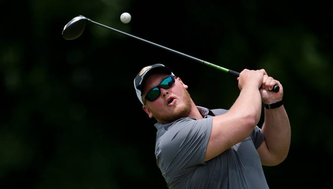 Alabama football's Bradley Bozeman attempts to tee off during a Alabama Fellowship of Christian Athletes event  on Monday, June 19, 2017, at Wynlakes Golf Club in Montgomery, Ala.