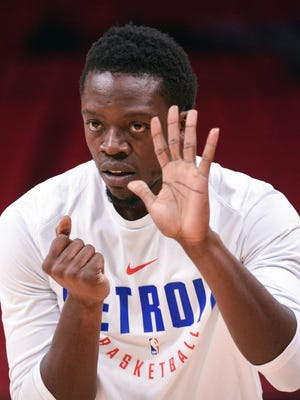 Pistons guard Reggie Jackson (1) warms up before the game against the Pacers on Tuesday, Dec. 26, 2017, at Little Caesars Arena.