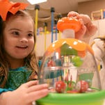 Harper Askea, 4, left, and her mother, Maria play at the Children's Center of Communication and Development on the campus of The University of Southern Mississippi Tuesday.