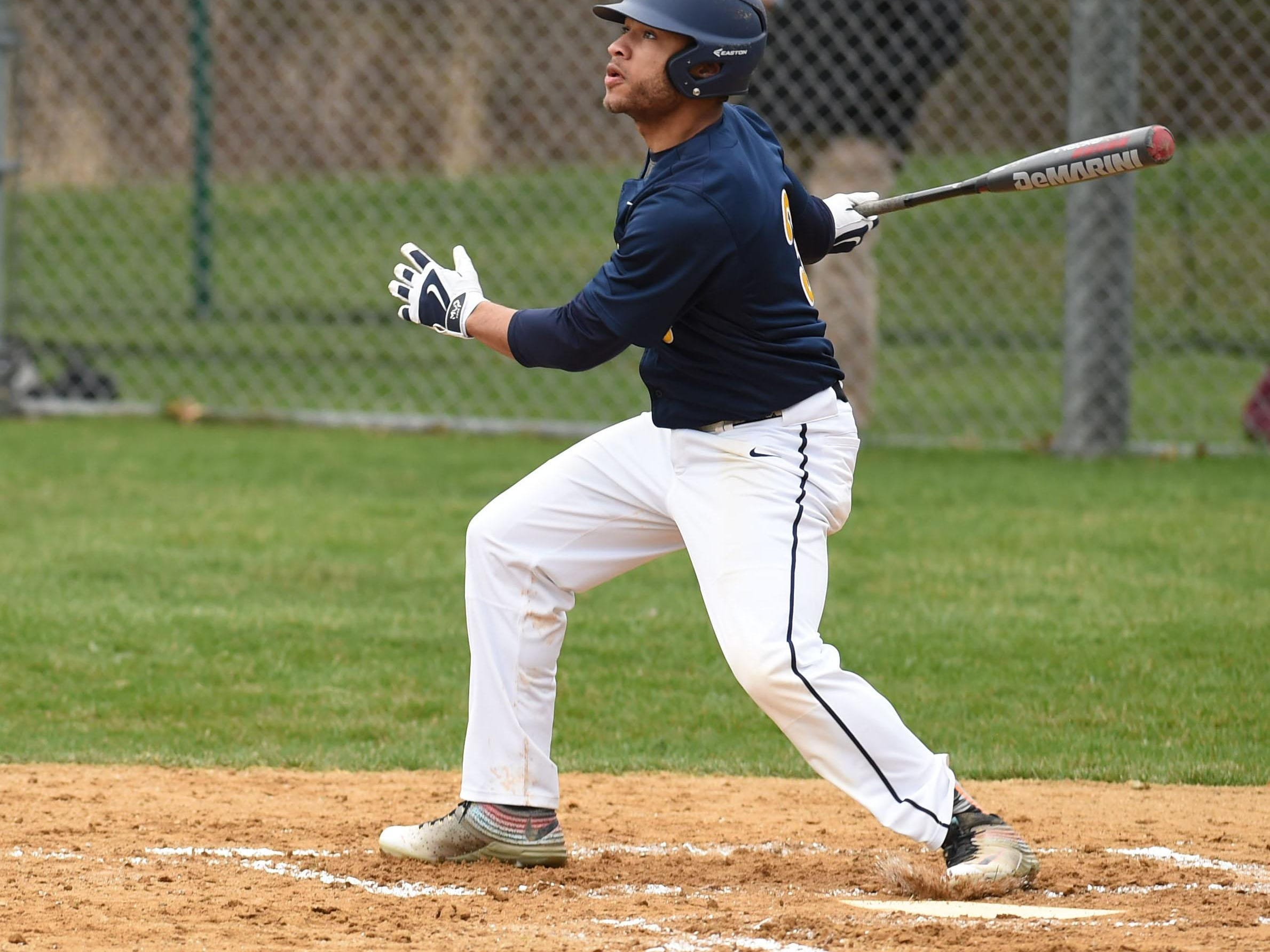 Highland's Isiah Daubon hits a fly ball during Monday's game against New Paltz.