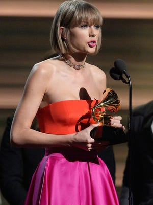 Taylor Swift called out Kanye West while accepting album of the year for '1989' at Monday's Grammy Awards.