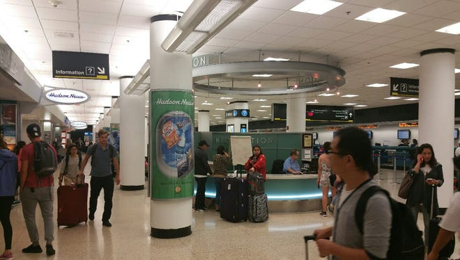 This photo, provided by Miami International Airport, shows passengers moving through the terminals as flights resumed there after Hurricane Irma.
