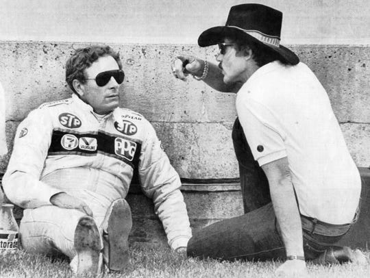 Don Whittington (l) talks with stock car driver Richard