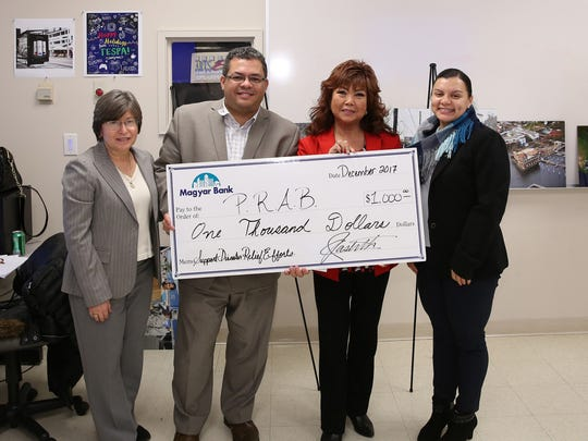 During the presentation of designs, Magyar Bank presented a check to   José Carlos Montes, chief executive officer of the Puerto Rican Action Board to help with the relief efforts. Left to right: Evelyn Rosa, José Carlos Montes, Carmen Oshiro, vice president/ business development officer; and Angie Agudelo, community relations specialist for Magyar Bank.