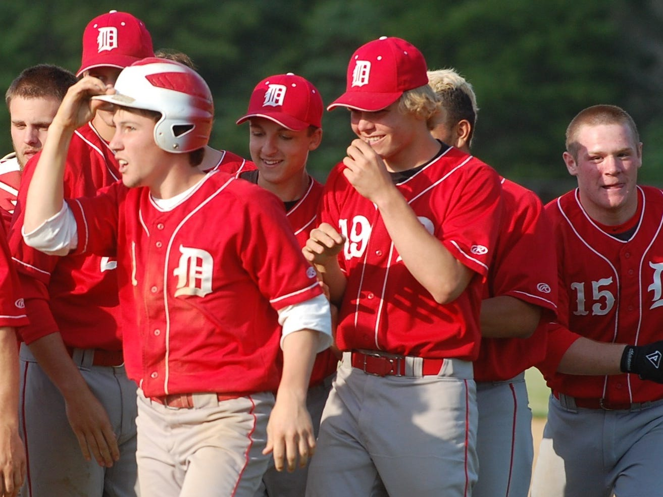 Delsea celebrates after Tom Carney (with helmet) was hit by a pitch Friday to drive in the winning run.
