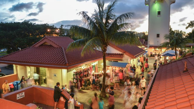 Bustling crowds fill the walkways of the Chamorro Village in Hagåtña at the Wednesday Night Market on Nov. 16, 2016.