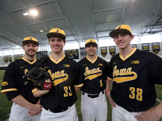 Iowa freshmen pitchers Cam Baumann, from left, Jack