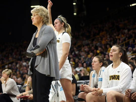 Iowa head coach Lisa Bluder watches her team face Indiana