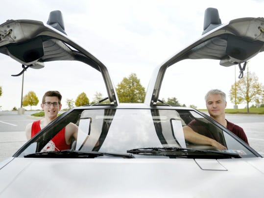 """Matt Bozievich of, Shrewsbury Township, and Justin Mettee, of Codorus Township, sit for a portrait in Mettee's 1981 DeLorean in the parking lot of the Wal-Mart in Shrewsbury. Oct. 21, 2015, is the date to which Marty McFly and Doc Brown travel to in the 1989 movie """"Back to the Future Part II."""""""
