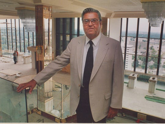 John Q. Hammons poses in The Tower Club in the 1980s, when the facility was under construction.