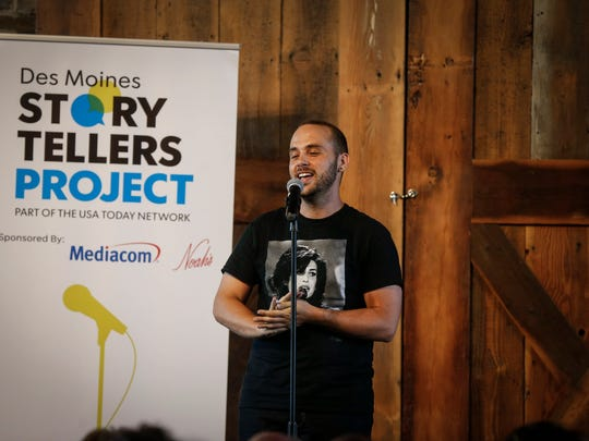 Jordon Deutmeyer shares his story of growing up as a gay man in a small town in Iowa during the Des Moines Storytellers Project at the River Center on Thursday, July 12, 2018, in Des Moines.