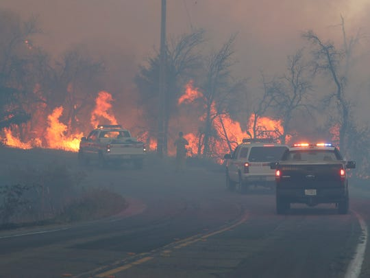 Crews work Sunday as spot fires pop up along Clear Creek Road.