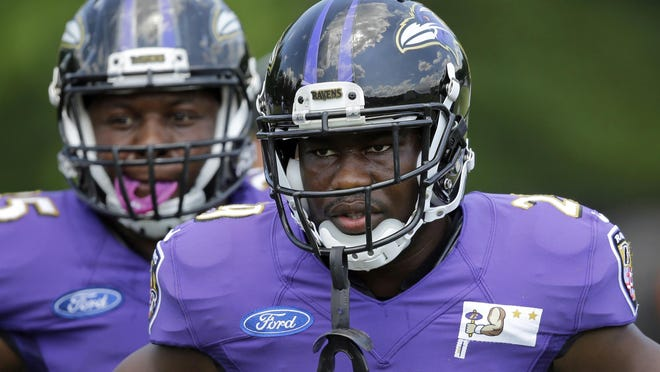 Ravens running back Justin Forsett stands in front of teammate Kiero Small during training camp Aug. 1 in Owings Mills, Md.